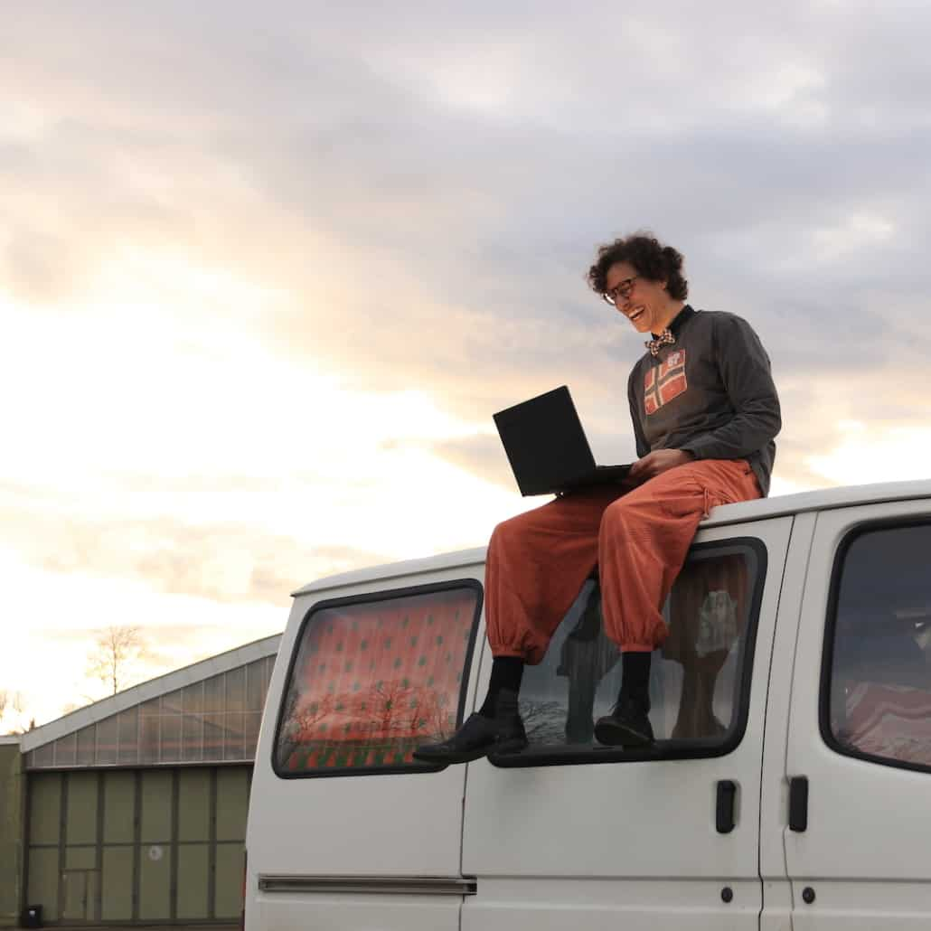Man sitting on bus and having fun in an online event