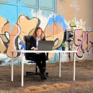 Woman in online meeting before a colorful background