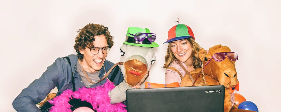 Two People Celebrating Online Carnival together - with costumes and a laptop