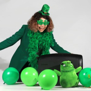 Woman in green St. Patrick's day costume before laptop