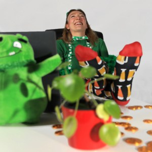 Woman laughing in online meeting with St. Patrick's day decoration
