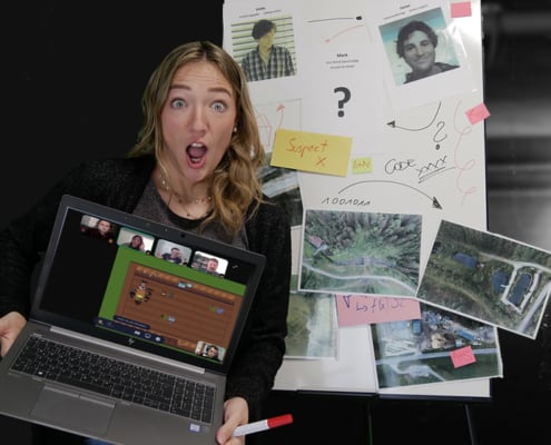 Girl scared holding a laptop with crime scene in Background
